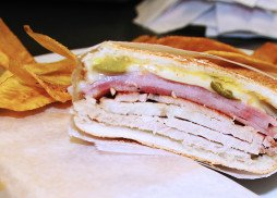Ham, roast pork, Swiss cheese, pickles and mustard with a homemade garlic spread on a Cuban roll